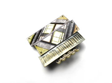 Looking out the window 5. Brooch. Patinated & gold plated brass, photographic paper, polycarbonate. © Blandine Halle 2017