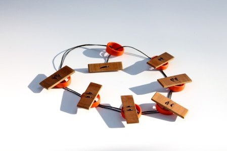 pendant, recycled plastic orange rings and wooden slates threaded together