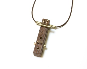 Ad lib (Day 18). Pendant. Found object, brass, leather cord.