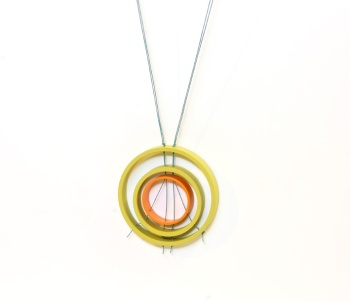 Follow the thread (Day 34). Pendant. Upcycled plastic, paint, thread.